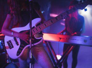 females-performing-on-illuminated-in-nightclub